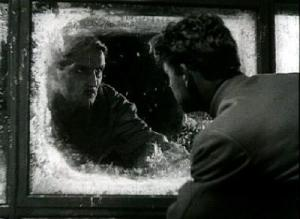 Kneishitz (left) glares at Martinov (right) through an icy window (Circus)